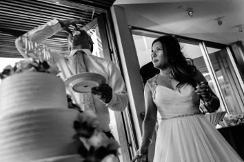 wedding coordination by magical moments by megan, venue scripps seaside forum, cake by king's hawaiian, bride and groom eating cake, Cerritos Wedding Planner, San Diego Wedding Planner, Orange County Wedding Planner, Los Angeles Wedding Planner