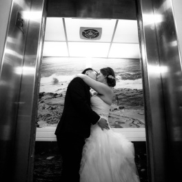 couple kissing on elevator